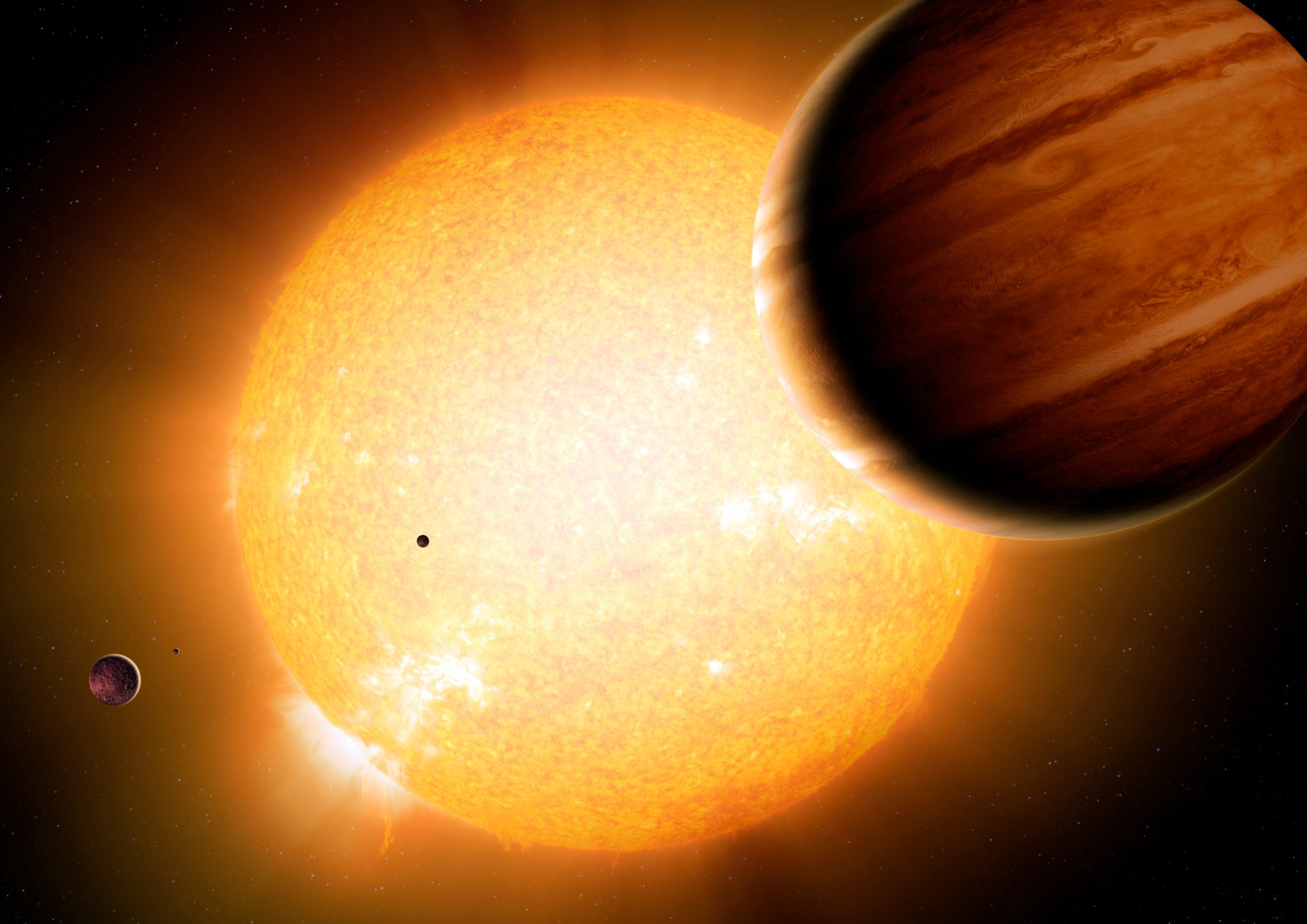 Alien planetary system. Computer artwork of a star (centre) and its planets. The planet's shown here have a mass similar to Jupiter but orbit much closer to their sun, meaning they have a much hotter surface temperature and giving them the name Hot Jupiters.