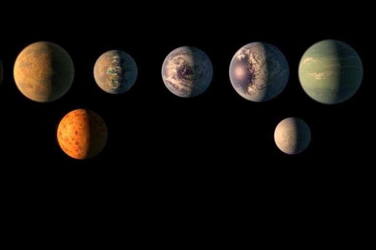 ricostruzione-artistica-di-come-potrebbero-apparire-i-sette-pianeti-del-sistema-trappist-1-crediti-n-55dec654bb583fca07075317a2184875b.jpg
